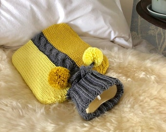 Hot water bottle with hand knit cover
