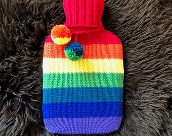 Hot water bottle with hand knit cosy