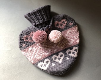 Heart shaped hot water bottle with hand knit cover