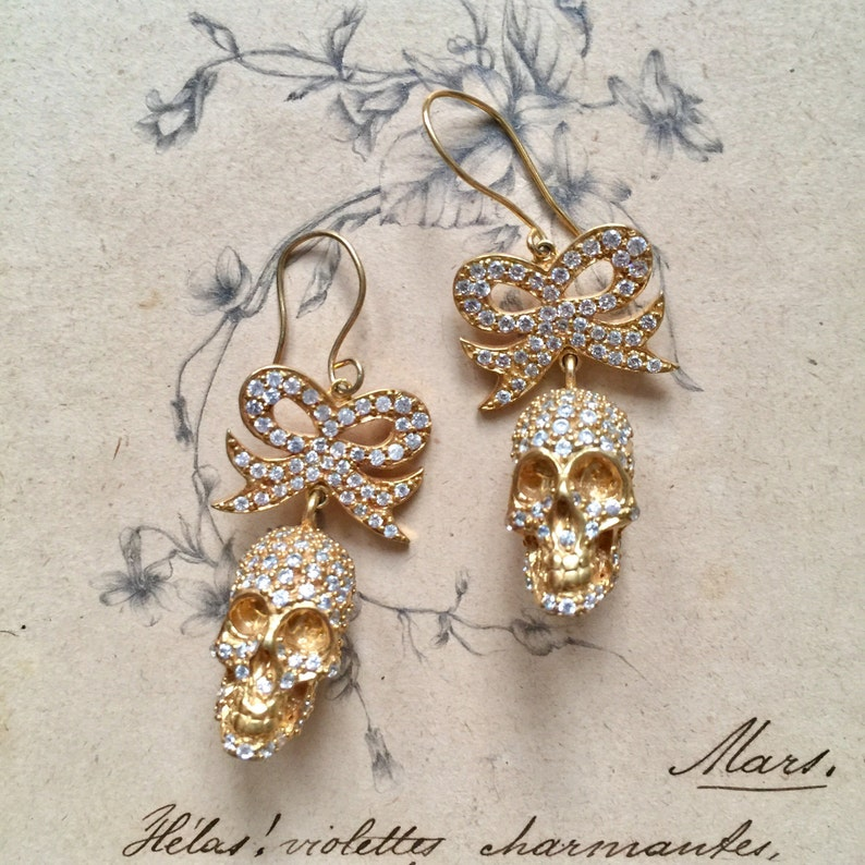 Pave crystal and bronze skull and bow earrings image 0