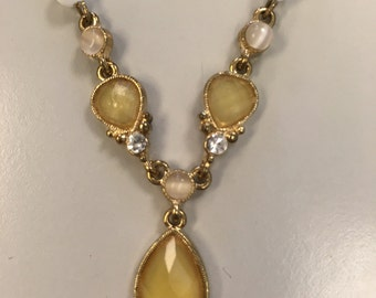 Vintage costume jewellery necklace with yellow stones and white beads