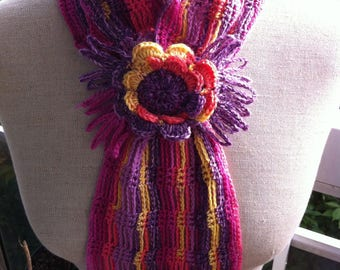 Small multicolor neck warmer and flower