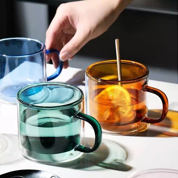 Double wall, mouth blown Colorful glass mug.