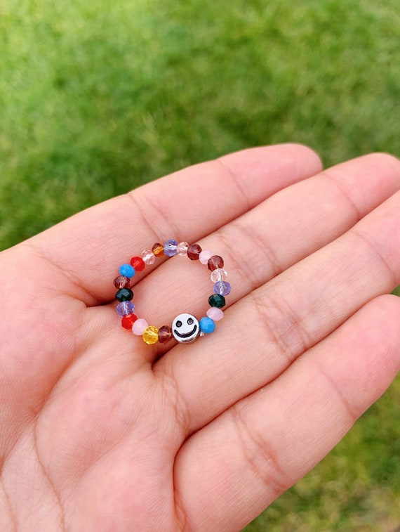 Smiley face rainbow beads ring.