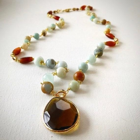 Necklace with quartz pendant and amazonite beads
