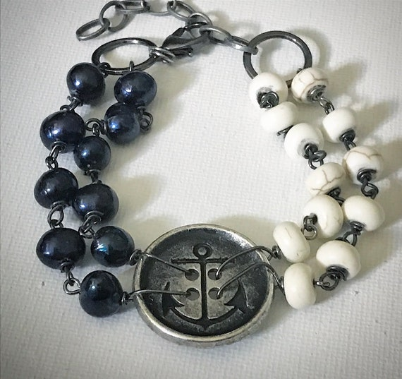 Nautical bracelet with brass button pendant