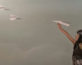 Print of original painting 'Breaking Formation', girl with paper plane in aviator hat and goggles