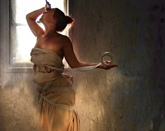 """Fine Art Composited Print """"Under Construction"""" of a woman wrapped in sheets and tape by a window"""