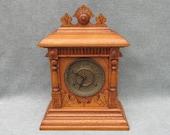 Antique 1875 Ingraham Mantle clock 8 day 1 2 hour strike carved columns finials brass face Oak wood table shelf display Vintage excellent