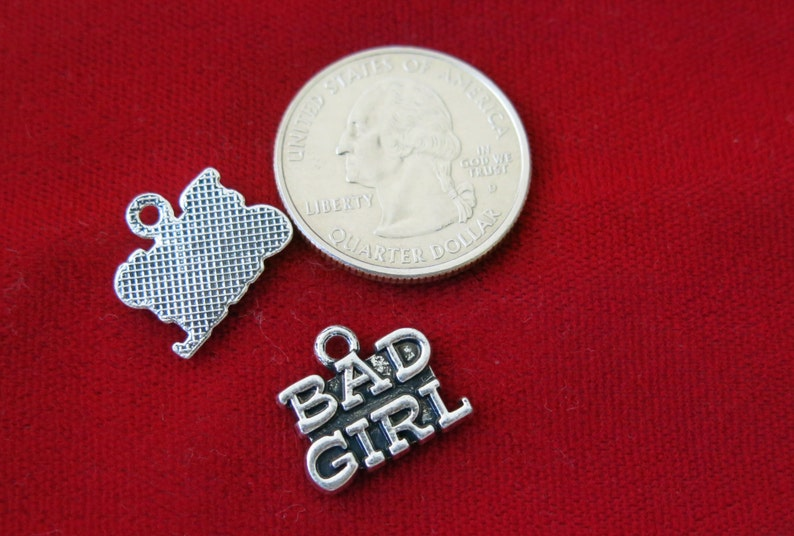 BC804 10pc Bad girl charms in antique silver