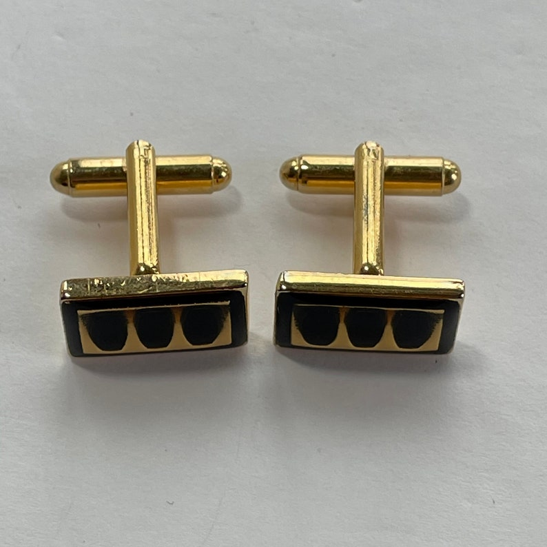 Black and gold cufflinks