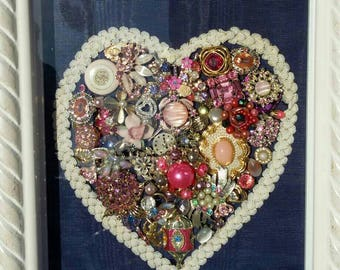 Jewel encrusted heart in shades of pink on blue moire in shadowbox