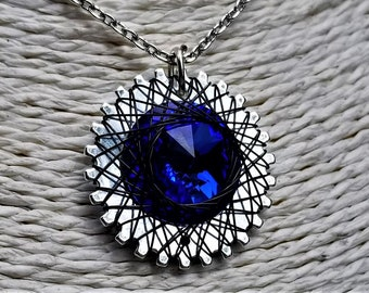Spirograph Inspired Dark Sapphire Blue Swarovski Crystal Pendant in Silver Setting with Black Wire