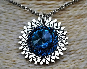 Spirograph Inspired Light Blue Swarovski Crystal Pendant in Silver Setting with Silver Wire