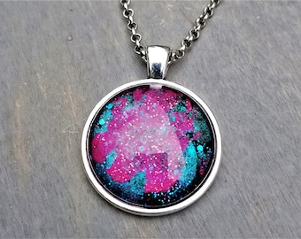 Hand Painted Glass Pendant: Bright Pink Nebula with Deep Teal Background (Necklace or Keychain)