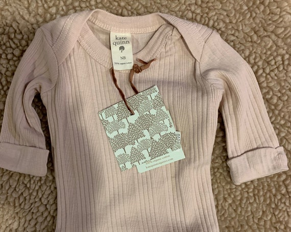 NB Kate Quinn Pink ribbed bodysuit for Dylan and Carissa