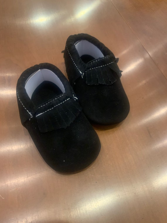 Black baby moccasins for Gabrielle and Tyler Hindman