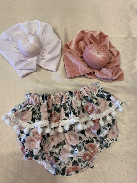 Pink and green floral ruffle baby bloomers with white Pom Pom trim
