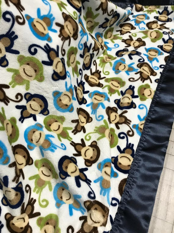 Monkeys all around minky baby blanket with navy satin backing and binding