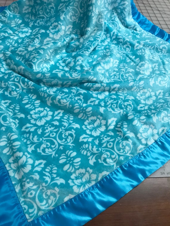 Minky patterned turquoise blanket with Caribbean blue satin 30 x 35