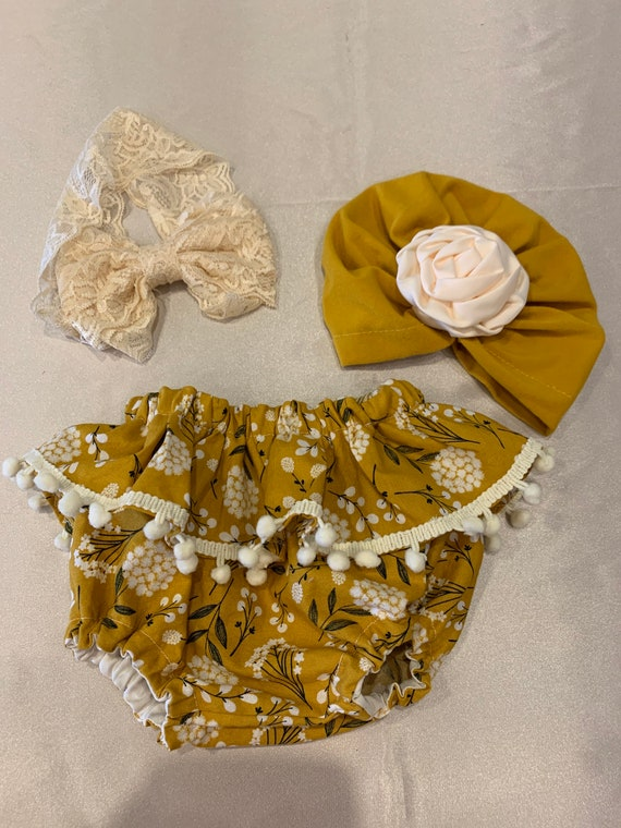 Mustard ruffle baby bloomers with Pom Pom trim