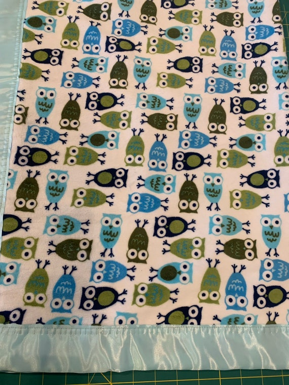 29 x 34 Blue owls with blue satin backing and baby blue binding