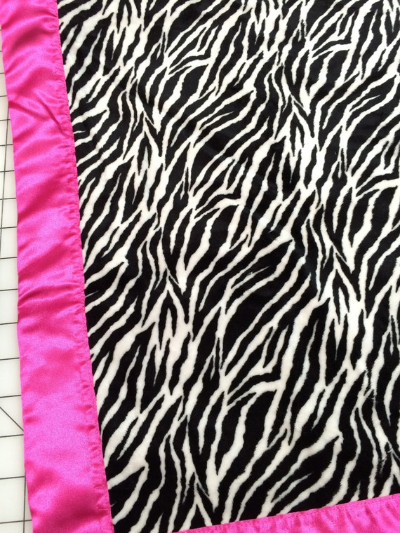30 x 35 zebra stripe minky blanket with hot pink satin backing and binding