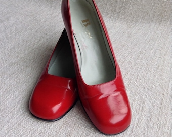 Vintage Canadian Browns iconic red leather pumps