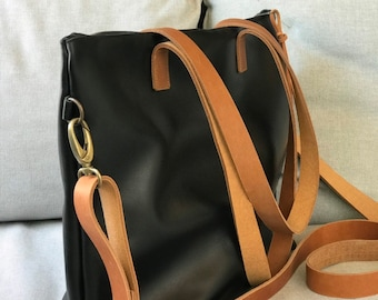 Black Leather bag with zip and brown leather straps.