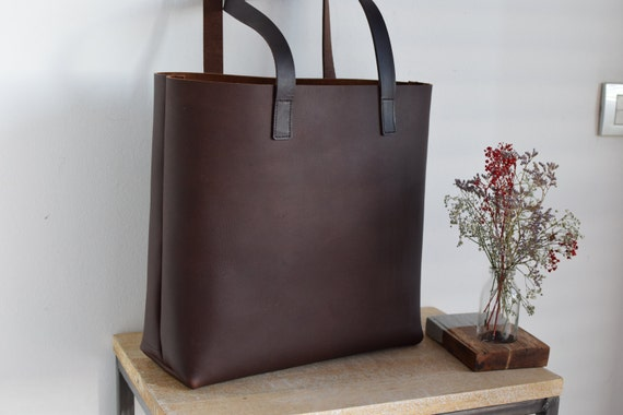 9d759a5740 Large Dark Brown Leather tote bag handles sewn.