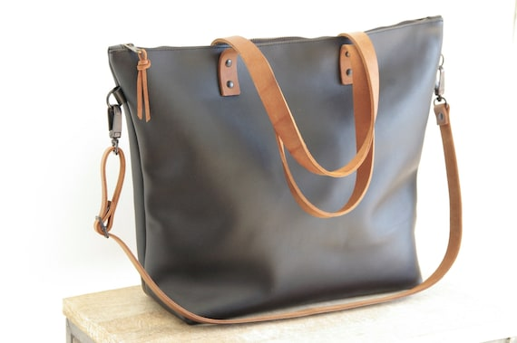 d640c04e46f6 Large Black Leather bag with Brown Straps. Zip and removable