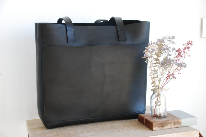 4f81ec178c Black Leather tote bag with large outside pocket. Cap Sa Sal