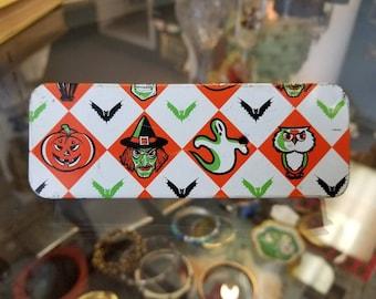 Vintage Halloween lithograph noisemaker