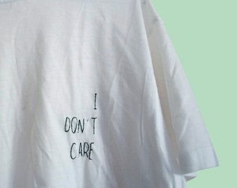 I don't CARE/free Embroidery T-Shirt