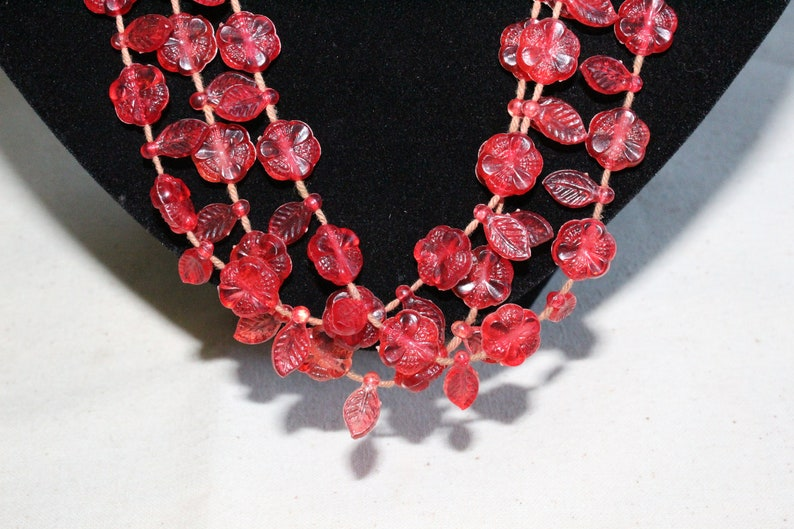 Vintage Three Strand Red Plastic Leaf And Flower Necklace