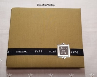 Ready Made Photo Scrapbook with Four Seasons Motif, You add the Pictures and Ephemera presented by Donellensvintage