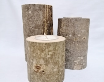 3 candlesticks made of raw ash wood