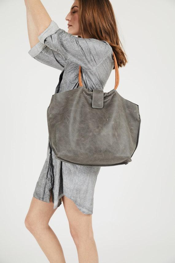 Hoe onderhoud je een lederen handtas? – Nina Shop