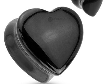 A Pair Of Heart Shaped Black Onyx Natural Stone Saddle Plugs
