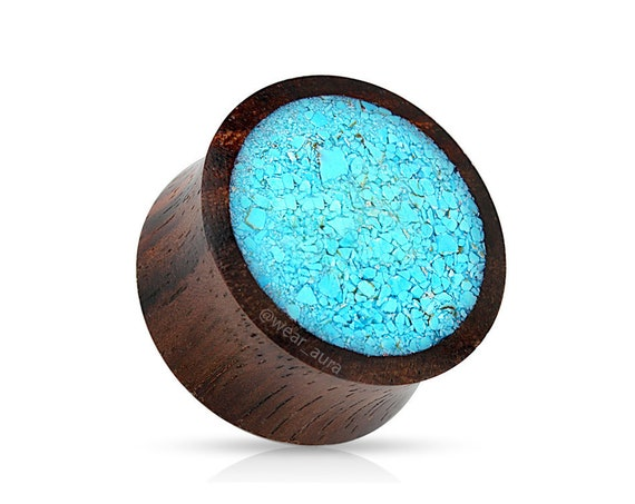 A Pair of Organic Wood Saddle Fit Plugs with Crushed Turquoise Inlay Front