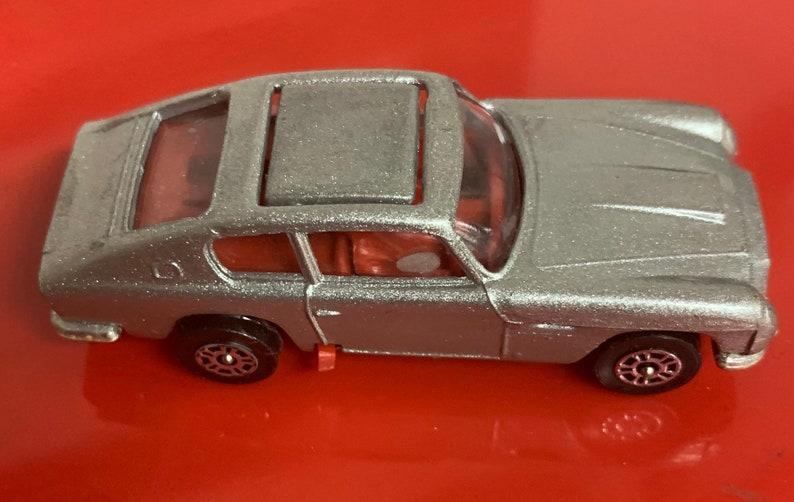 Vintage 1970s Corgi Jr. James Bond Aston Martin image 0