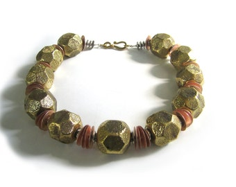 Mundo de Oro: Brass, copper, silver wash. Necklace and earring set.