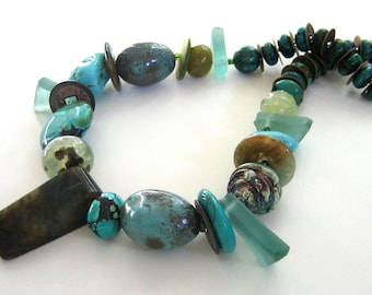 Blue Biffy: Innovative, sophisticated turquoise and jadeite necklace and earring set