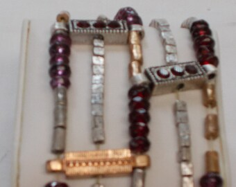Bracelet, Multi-stranded with Ruby, Garnet and Amethyst Colored Beads.  (854)