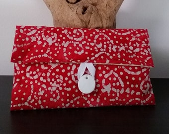Red and white, batik-style print fabric clutch bag