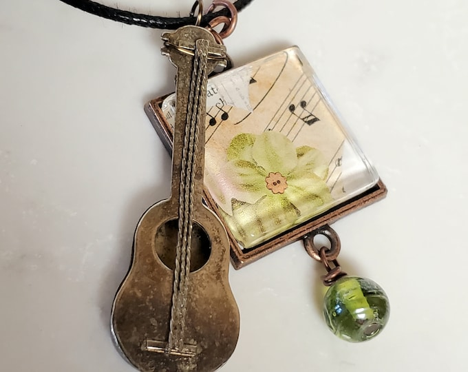 Green Flower Pendant Necklace with Whimsical Guitar Charm on Leather, one of a kind necklace