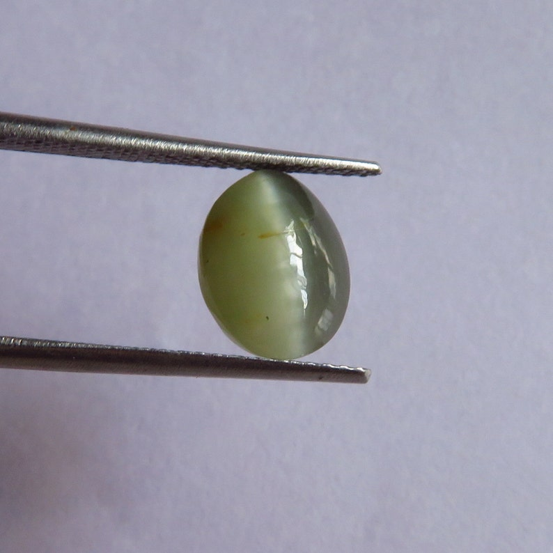 2 50 Ct  Natural Cats eye  In attractive light apple green color with  prominent chatoyancy