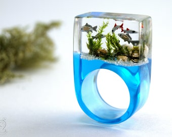 Etsy Design Awards Finalist: Aquarium – Magnificent fish ring with silver ornamental fish, sand, stones & moss on a blue ring made of resin