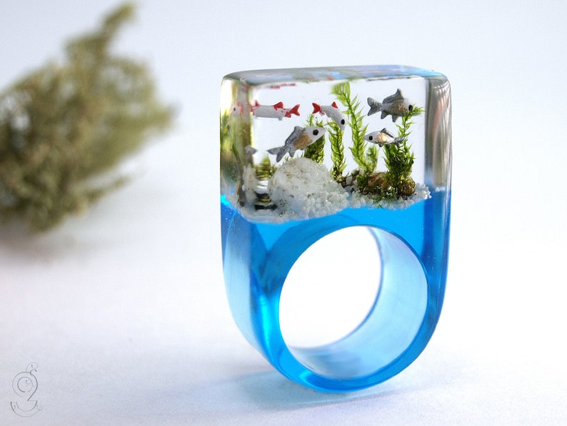 stones /& moss on a blue ring made of resin Etsy Design Awards Finalist Aquarium \u2013 Magnificent fish ring with silver ornamental fish sand