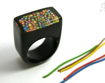 Cable spaghetti – abstract ring with colorful cutted copper cables in black and transparent resin